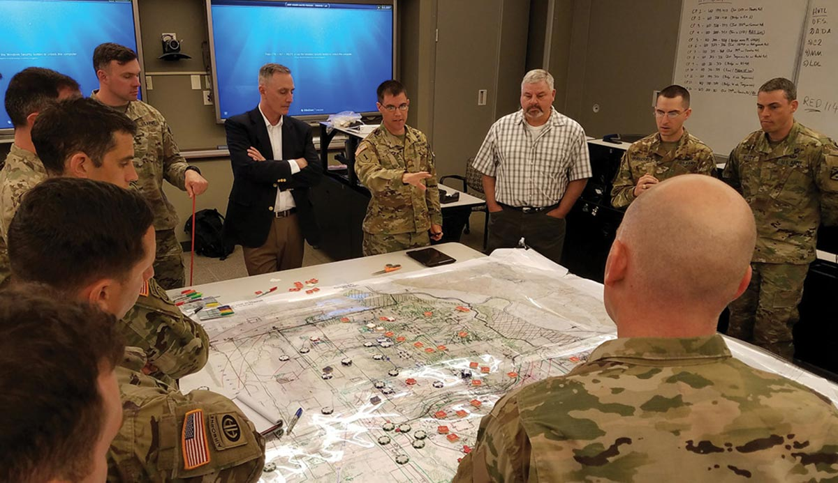Maj. Matt Hill briefs Decisive Action Tactical Application Course instructors and fellow student brigade staff members during a decision briefing exercise 19 April 2017 at Fort Leavenworth, Kansas.