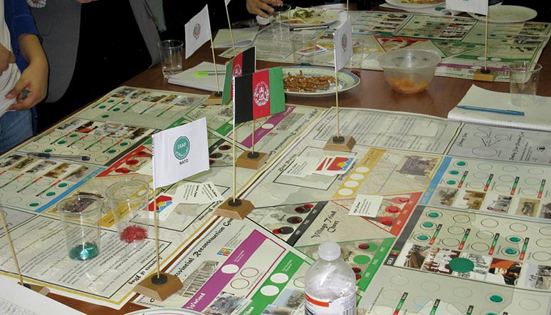 Emulating military sand table techniques used for planning combat operations, a board game titled Stabilization Operations in Highly Religious Societies was developed by Law Enforcement Crisis Management (LECMgt)