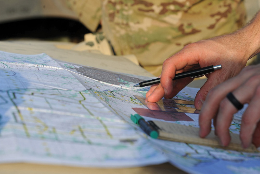JTAC airmen reads a map