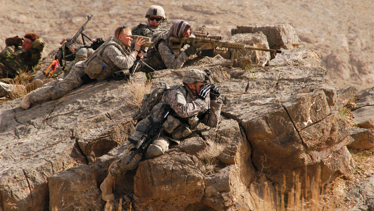 1st Lt. Patrick Higgins (foreground) of 1st Battalion, 4th Infantry Regiment surveys a village as Spc. Aaron Trapley and Sgt. Gary Fordyce provide sniper overwatch and Sgt. Nicholas Gauthier provides security during a foot patrol 23 February 2009 near Forward Operating Base Mizan, Afghanistan. To deal with the extreme stress and moral ambiguity of such situations, the authors assert that high standards and methods for ethical decision making need to be inculcated  in troops and their leaders through intensive education. (Photo by Sgt. Christopher S. Barnhart, U.S. Army)