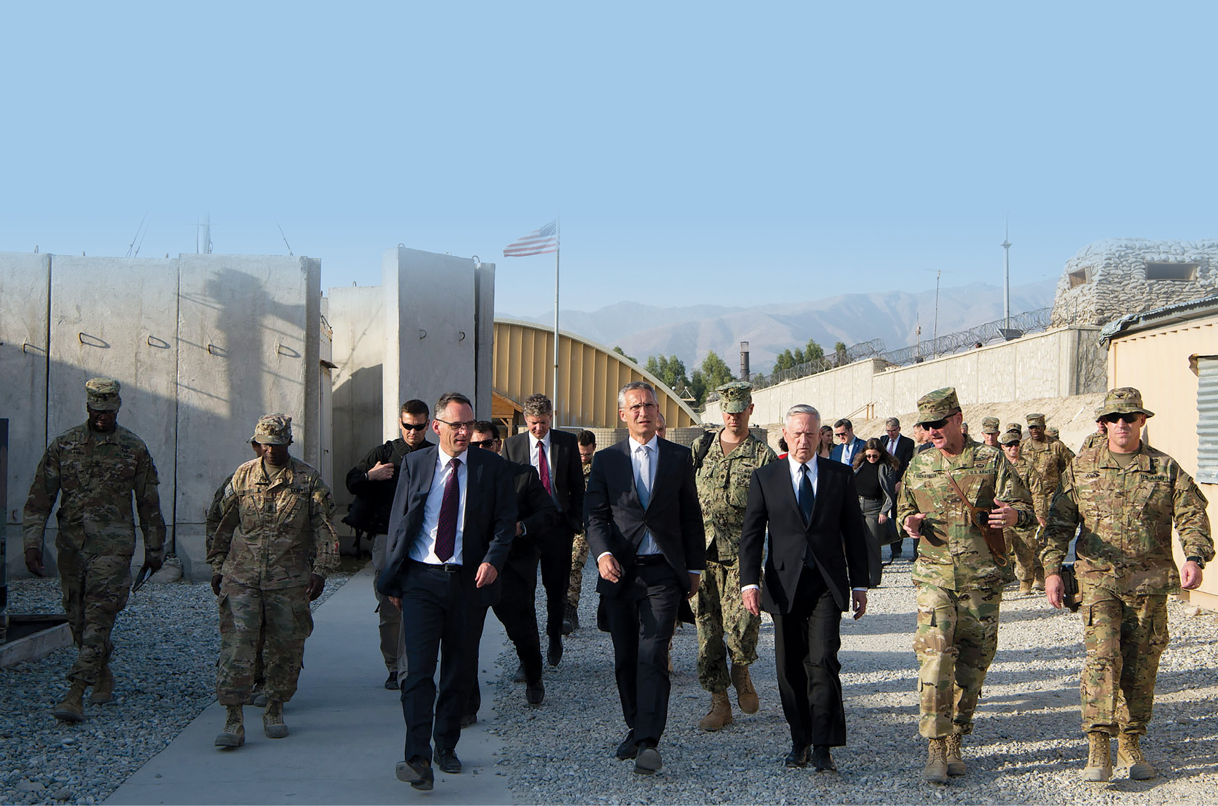 U.S. Secretary of Defense Jim Mattis (third from right) and NATO Secretary General Jens Stoltenberg (fourth from right) walk to a meeting 27 September 2017 with deployed forces in Afghanistan. (Photo by Staff Sgt. Jette Carr, U.S. Air Force)