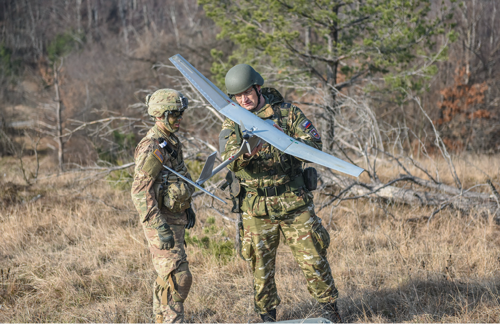 A paratrooper with 1st Squadron, 91st Cavalry Regiment, 173rd Airborne Brigade and a Slovenian soldier assemble and launch an RQ-11B Raven unmanned aerial vehicle 1 December 2016 during Exercise Mountain Shock in Cerklje, Slovenia. The drill was part of a situational training exercise designed to train and test their reaction to contact and tactical battle drills. (Photo by Staff Sgt. Philip Steiner, U.S. Army)