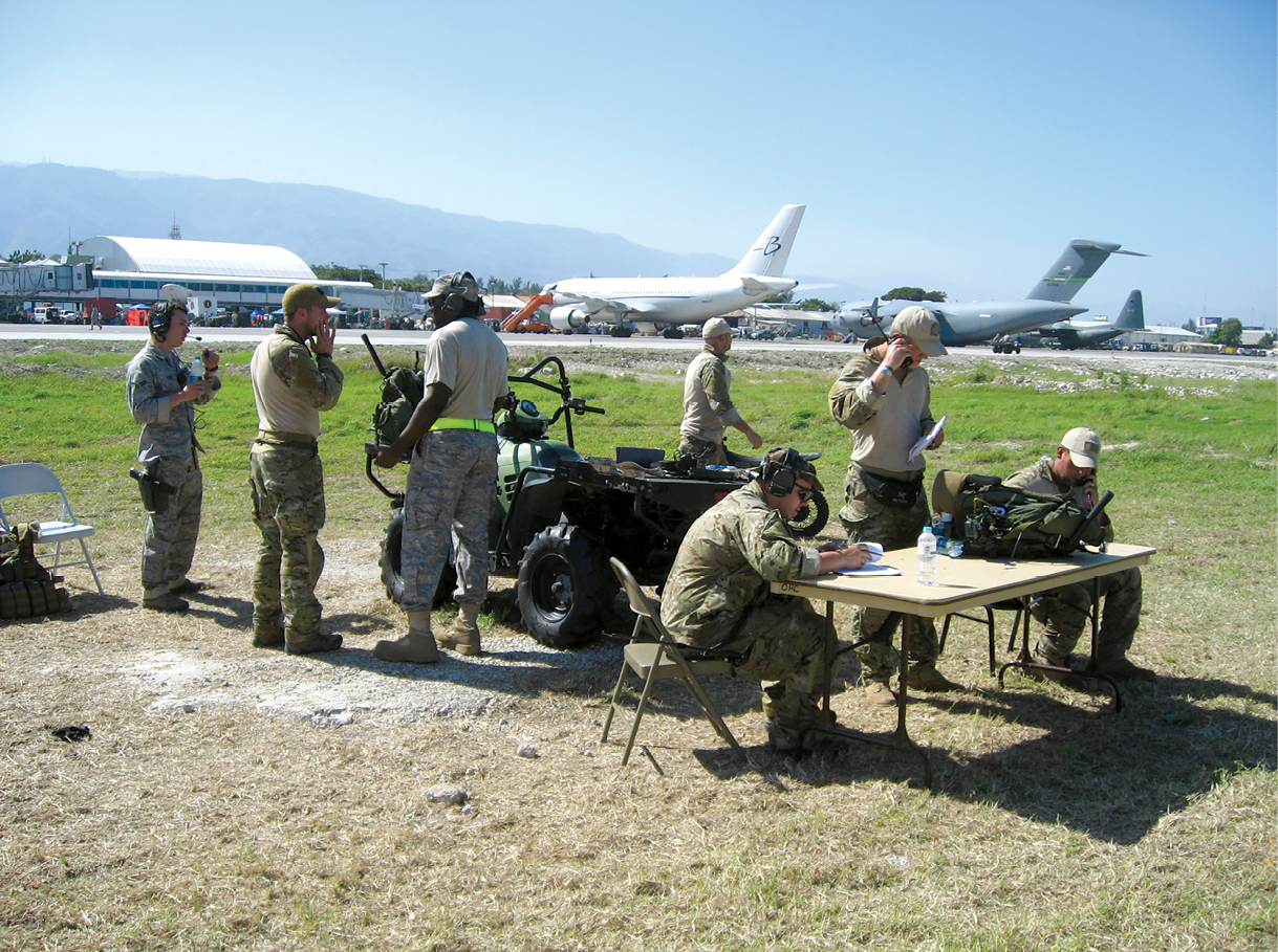 Aviation experts from various U.S. agencies work under austere conditions 12 January 2010 to ensure ramp operations and slot times are processed for inbound and outbound air traffic into Haiti's Toussaint Louverture International Airport.