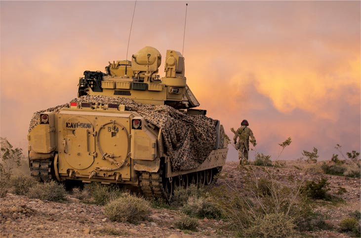 An M2 Bradley Fighting Vehicle provides security for the 2nd Armored Brigade Combat Team