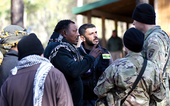 Soldiers assigned to the U.S. Army John F. Kennedy Special Warfare Center and School speak with indigenous civilian role players