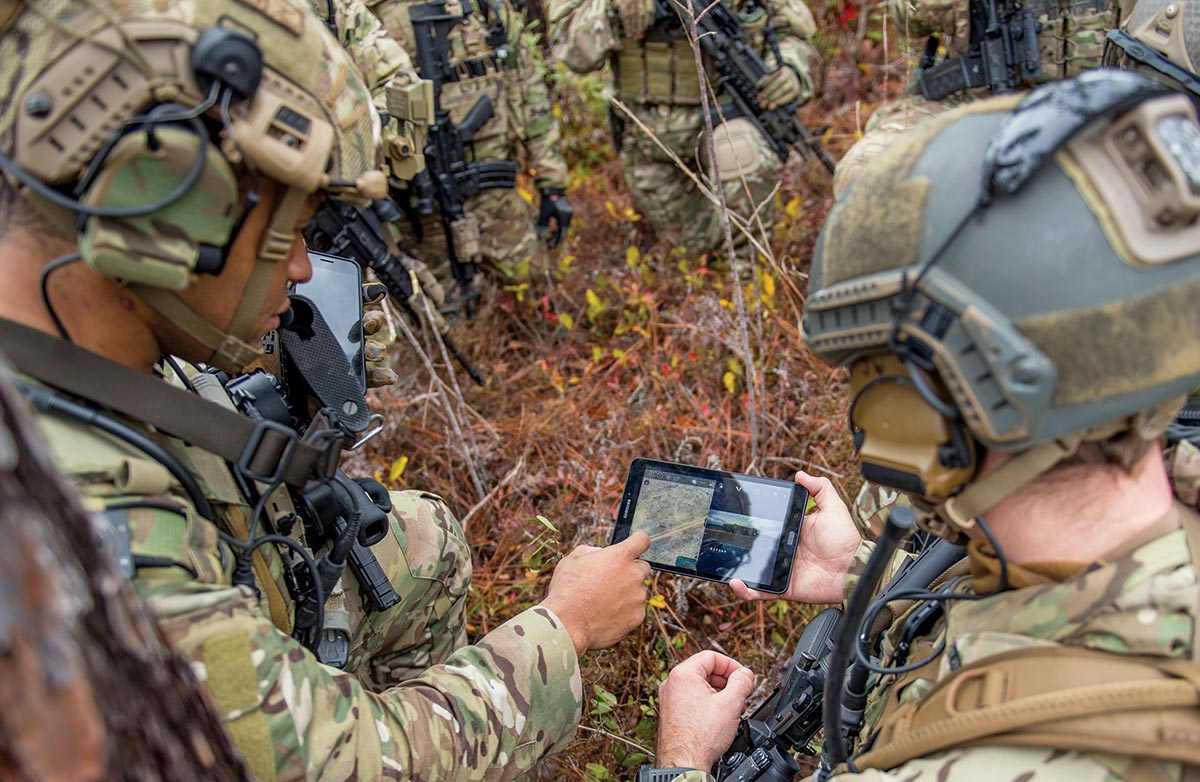Members of the 6th Special Operations Squadron use a tablet to upload coordinates 17 December 2019 during an exercise showcasing the capabilities of the advanced battle management system (ABMS) at Duke Field, Florida.