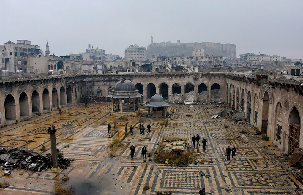 Syrian troops and pro-government gunmen walk inside the destroyed Umayyad Mosque 13 December 2016 in Aleppo, Syria. (Photo courtesy of Syrian Arab News Agency)