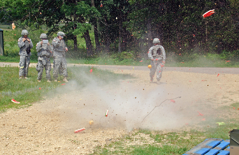 To show the power of blasting caps, and the need for safety around them, 89B course instructors blew up some fruit with blasting caps at the end of the day at the demolition field at Fort McCoy, Wis. (Photo by Jonathan (Jay) Koester / NCO Journal)