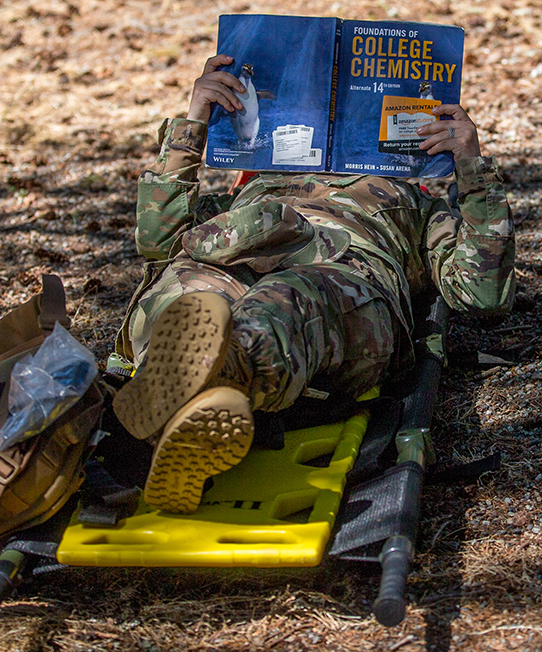 Not letting a spare moment go to waste, a medic studies during a break in the action for the 2017 Madigan Army Medical Center's Best Medic Competition at Joint Base Lewis-McChord, Tacoma, WA, on July 25, 2017. (Photo by John Liston)