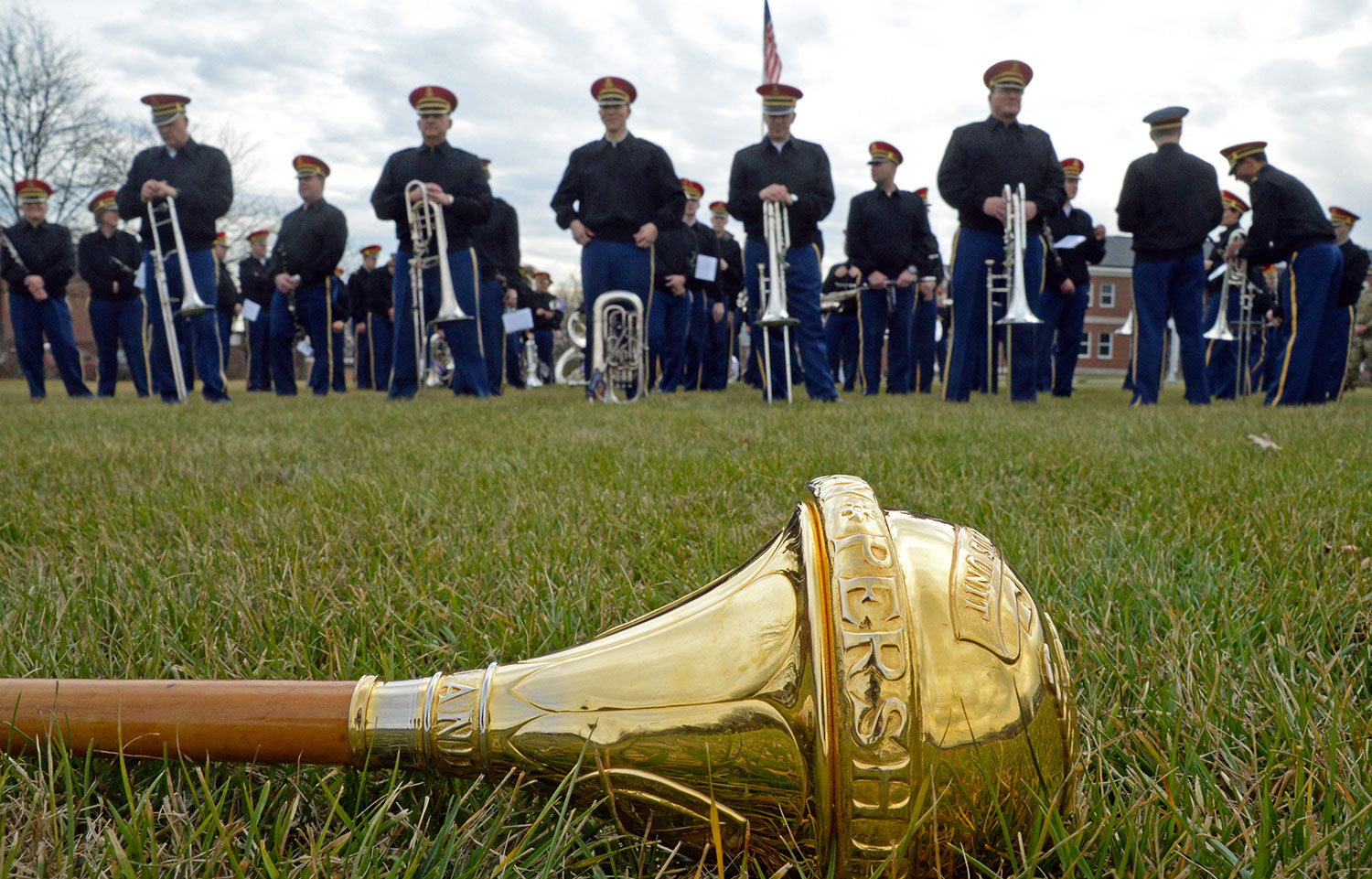 "The baton of Sgt. Maj. Julian R. Ayers Sr., the drum major for U.S. Army Band ""Pershing's Own,"" lies on the ground during a rehearsal on Summerall Field at Fort Myer, Virginia. The band was preparing for the inaugural parade. (Photo by Jonathan (Jay) Koester / NCO Journal)"
