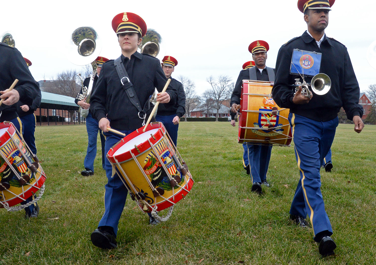 "Staff Sgt. Sidonie H. Wade (center), a percussionist for U.S. Army Band ""Pershing's Own,"" marches during a rehearsal on Summerall Field at Fort Myer, Virginia. The band was preparing for the inaugural parade. (Photo by Jonathan (Jay) Koester / NCO Journal)"