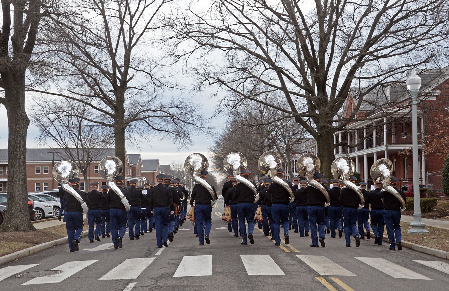 "The U.S. Army Band ""Pershing's Own,"" marches down Sheridan Avenue during a rehearsal at Fort Myer, Virginia. The band was preparing for the inaugural parade. (Photo by Jonathan (Jay) Koester / NCO Journal)"