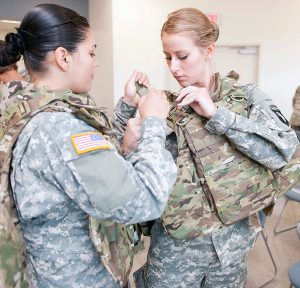 Soldiers of the 101st Airborne Division's 1st Brigade test female body armor. In a collaborative effort, the U.S. Army Natick Soldier Research, Development and Engineering Center worked with Program Executive Office Soldier on an improved outer tactical vest designed specifically for women. The innovation was named one of Time Magazine's Best Inventions in 2012. (Photo courtesy of Natick Soldier Research, Development and Engineering Center / U.S. Army)