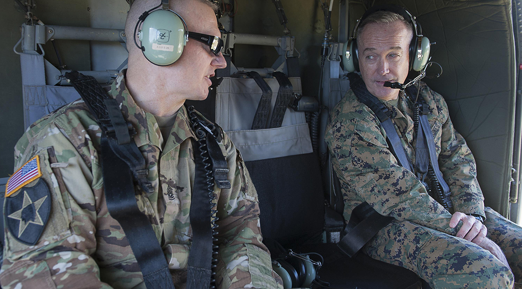 Army Command Sgt. Maj. John W. Troxell, senior enlisted advisor to the chairman of the Joint Chiefs of Staff, speaks to Marine Corps Gen. Joe Dunford, the chairman of the Joint Chiefs of Staff, aboard a UH-60 Black Hawk helicopter in Hawaii. (Photo by Navy Petty Officer 2nd Class Dominique A. Pineiro)