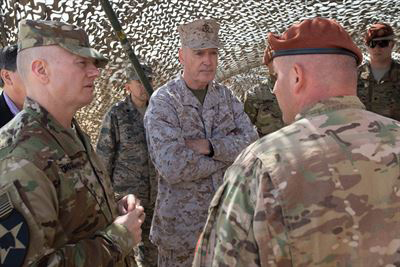 Army Command Sgt. Maj. John W. Troxell, left, senior enlisted advisor to the chairman of the Joint Chiefs of Staff, and Marine Corps Gen. Joseph F. Dunford Jr., center, chairman of the Joint Chiefs of Staff, listen to a brief during a visit to the North Camp in the Sinai Peninsula of Egypt. (Photo by D. Myles Cullen)