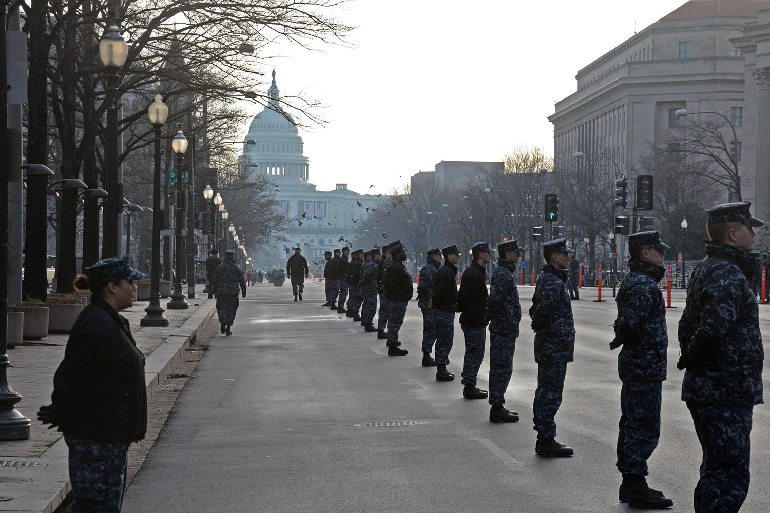 Members of the Joint Honor Guard stand at attention during a early morning rehearsal for the 58th Presidential Inauguration in Washington D.C. The rehearsal was held on Jan. 15, 2017, the Sunday before the inauguration. (Photo by Jonathan (Jay) Koester / NCO Journal)