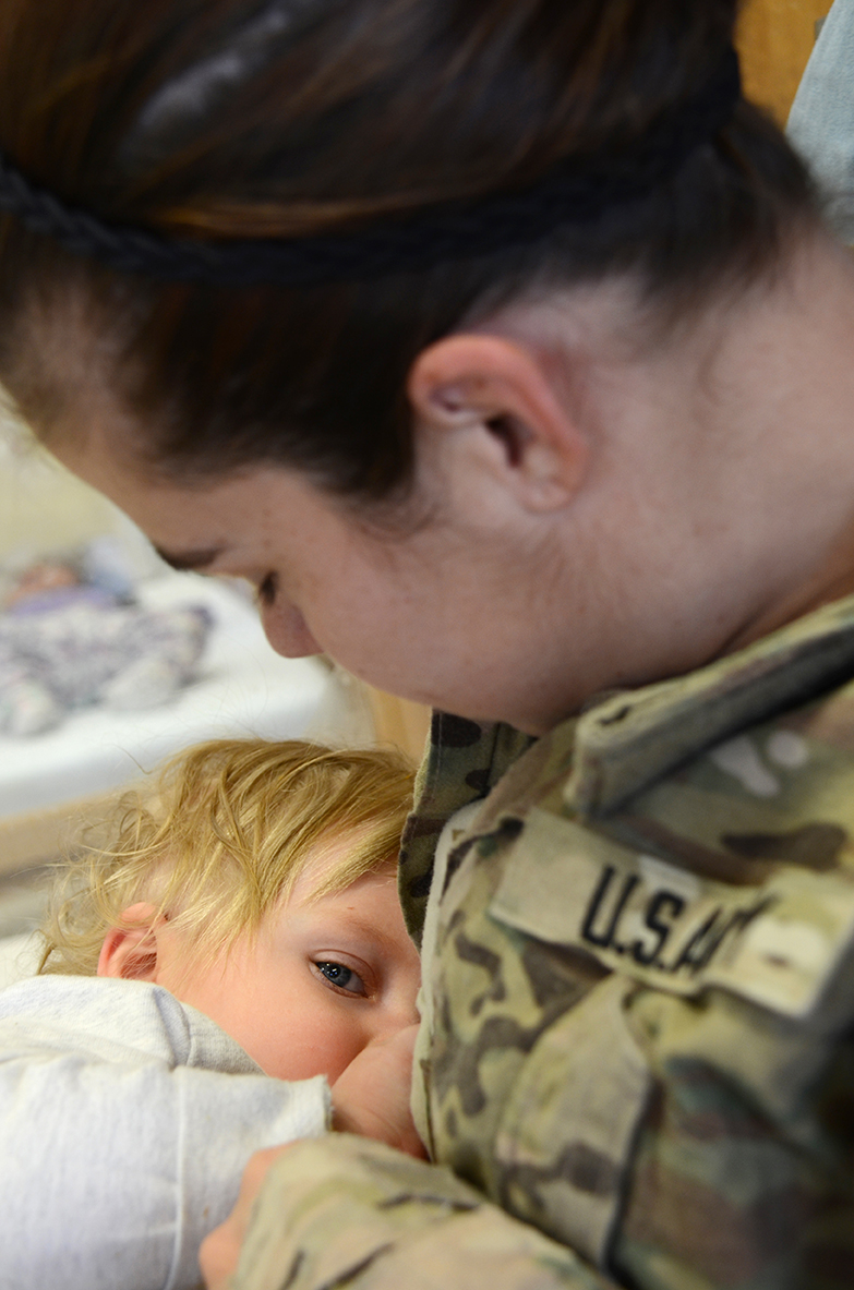 Cpl. Brittany Sandoval of 1st Battalion, 67th Armored Regiment, 3rd Brigade Combat Team, 1st Armored Division breastfeeds her 14-month-old daughter, Piper, before taking her home from a Child Development Center at Fort Bliss, Texas. Like many breastfeeding Soldiers, Sandoval visits the CDC on her lunch break to breastfeed her daughter. (Photo by Meghan Portillo / NCO Journal)