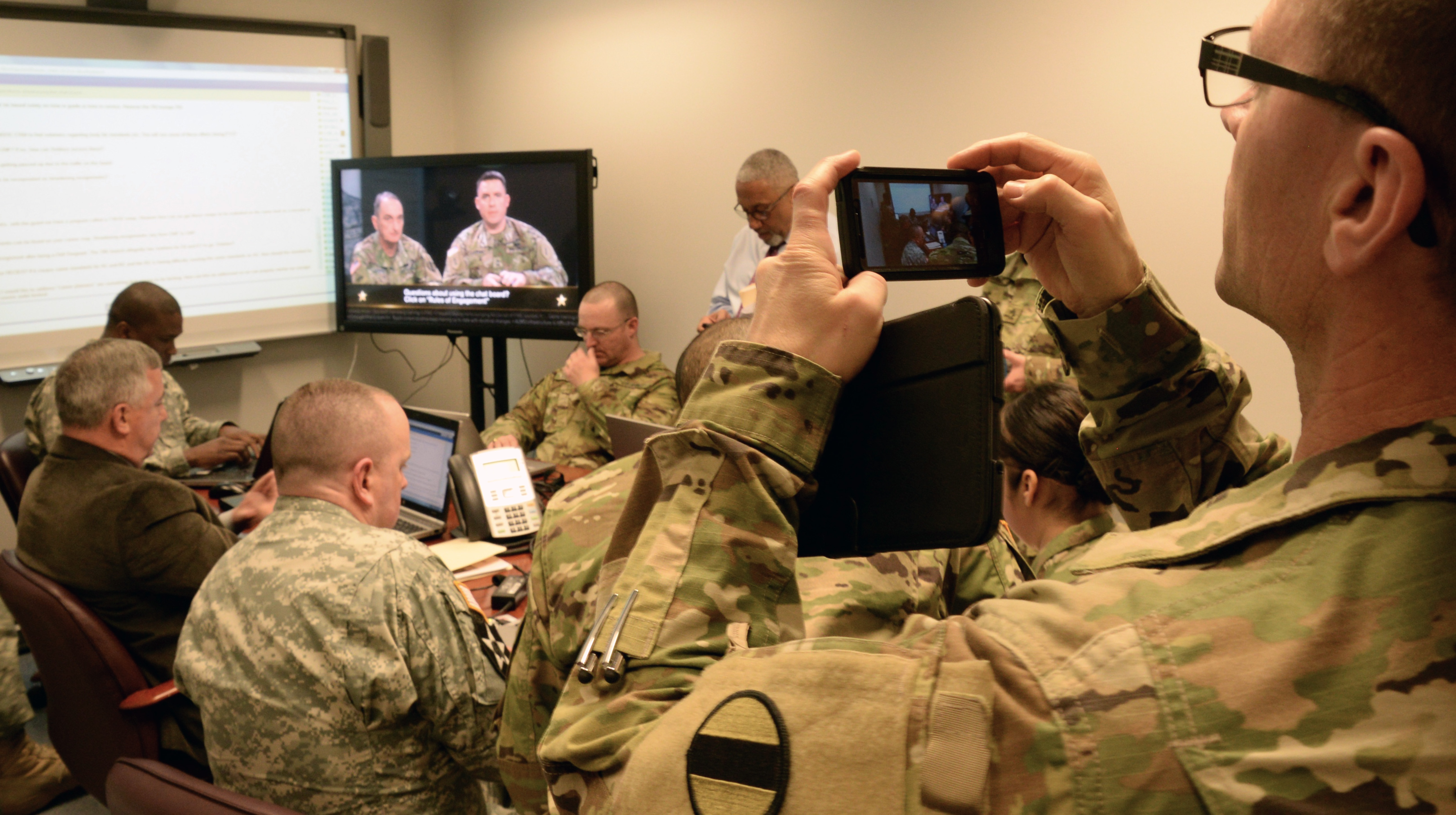 With the chat room questions displayed at the front of the room, a group of NCOs and experts answer questions during the town hall. (Photo by Jonathan (Jay) Koester / NCO Journal)
