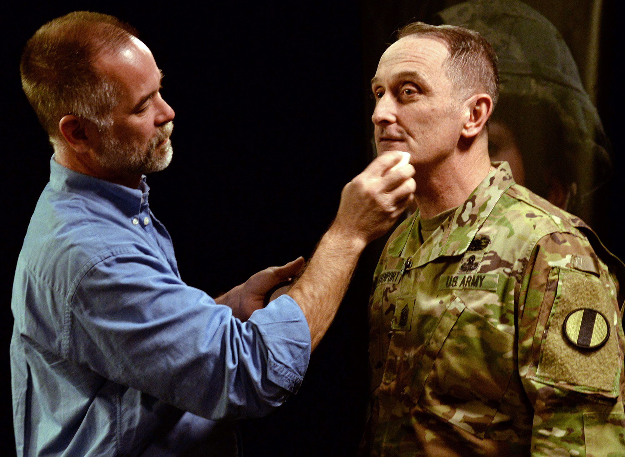 Command Sgt. Maj. David Davenport, command sergeant major of U.S. Army Training and Doctrine Command, has makeup applied before sitting under the bright lights of the town hall studio March 3 at Fort Eustis, Virginia. (Photos by Jonathan (Jay) Koester / NCO Journal)