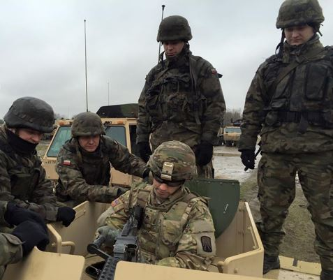 An NCO from the 51st Transportation Company demonstrated to Polish NCOs the proper technique to load/unload and clear an M240B Machine Gun during the field training exercise Knight's Quest. The exercise was conducted in Poland to build interoperability between Polish and U.S. logistic Soldiers. (U.S. Army photo by First Sgt. Louis Steinke)