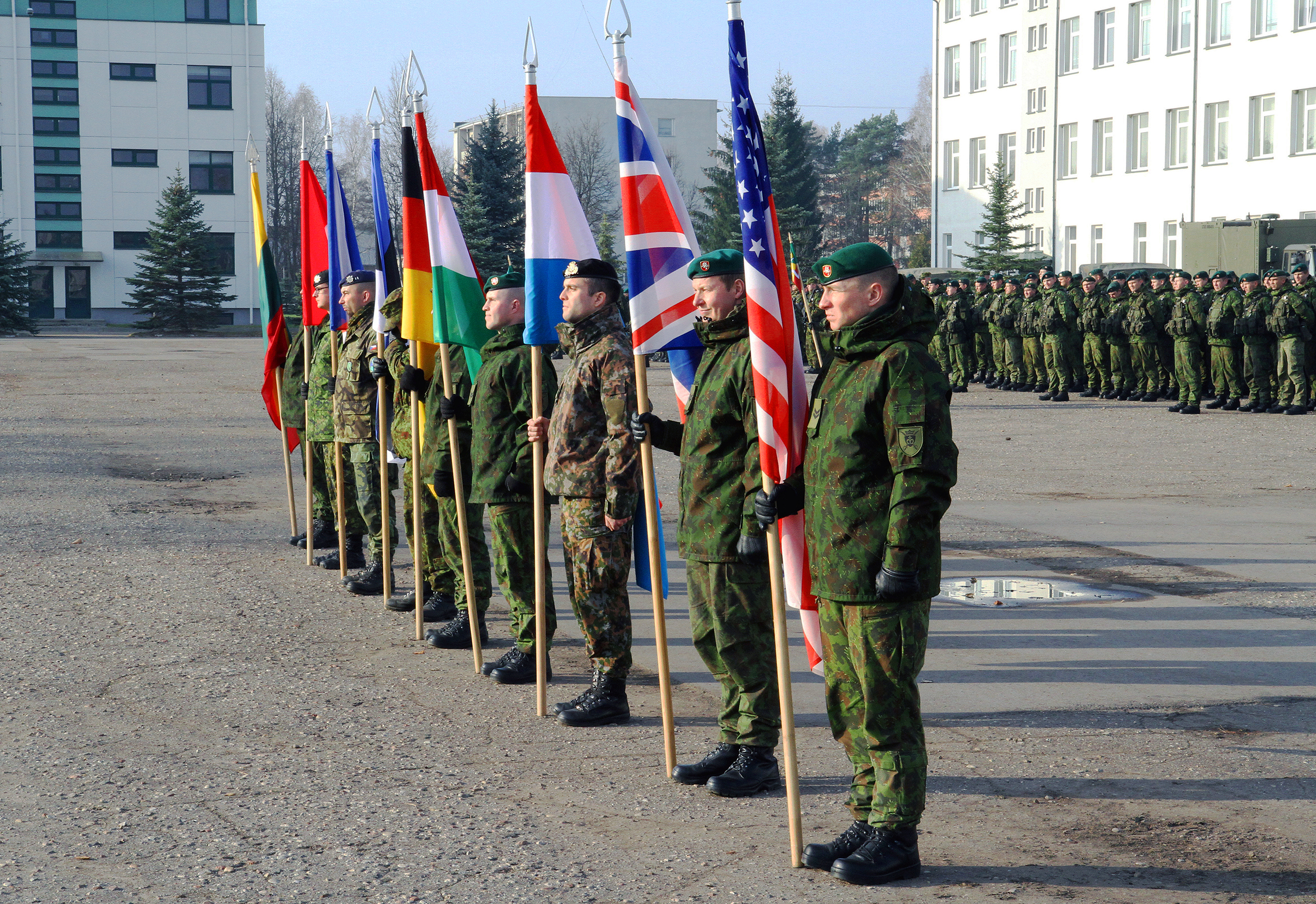 Servicemembers from Canada, the Czech Republic, Estonia, Hungary, Germany, Lithuania, Luxemburg, the United Kingdom and the United States display their country's flags at the commencement ceremony for Iron Sword 2014, an exercise incorporating all nine NATO countries, to enhance combined tactical competency and strategy. These activities are part of the U.S. Army Europe-led Operation Atlantic Resolve land force assurance training taking place across Estonia, Latvia, Lithuania and Poland to enhance multinational interoperability, strengthen relationships among allied militaries, contribute to regional stability and demonstrate U.S. commitment to NATO. (Photo by Spc. Seth LaCount)