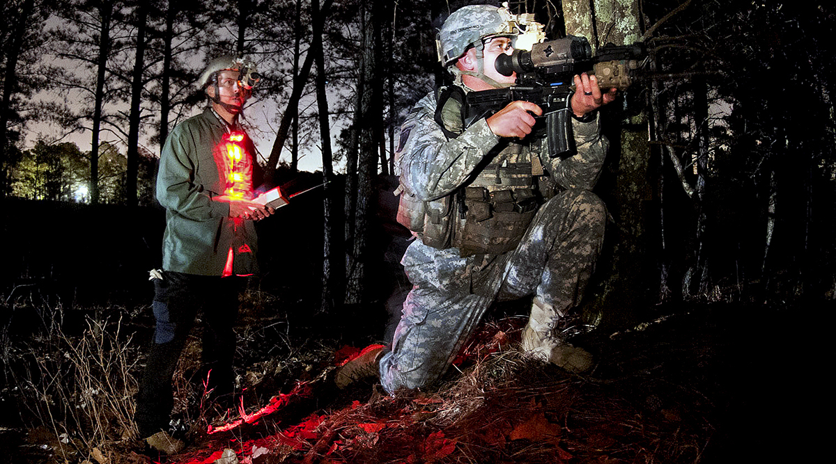 An advanced marksmanship instructor with PEO Soldier instructs a paratrooper on using a thermal imaging scope at night in January 2013 at Fort Bragg, North Carolina. Noncommissioned officers who serve as subject matter experts attend fieldings where Soldiers are trained on equipment. NCOs gather feedback and report back to PEO Soldier. (Photo by Sgt. Michael J. MacLeod / U.S. Army)