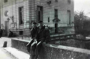 "Sgt. Richard Rogers poses with a fellow Soldier in France, circa 1944. On the back of the photo is written, ""Where I live and work. Nice, huh? That's me on the right."""