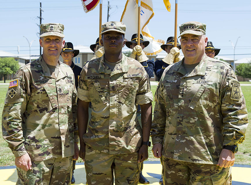 Sgt. Maj. of the Army Daniel A. Dailey, left, and Chief of Staff of the Army Gen. Mark A. Milley, right, have allowed Spc. Cortne K. Mitchell, A Company, 15th Brigade Support Battalion, 2nd Armored Brigade Combat Team, 1st Cavalry Division, and all the other Soldiers at Fort Hood, Texas, to roll up their sleeves, for a 10-day trial period to evaluate the practicality of sleeve-rolling across the Army. (Photo by Sgt. 1st Class Charles E. Burden)