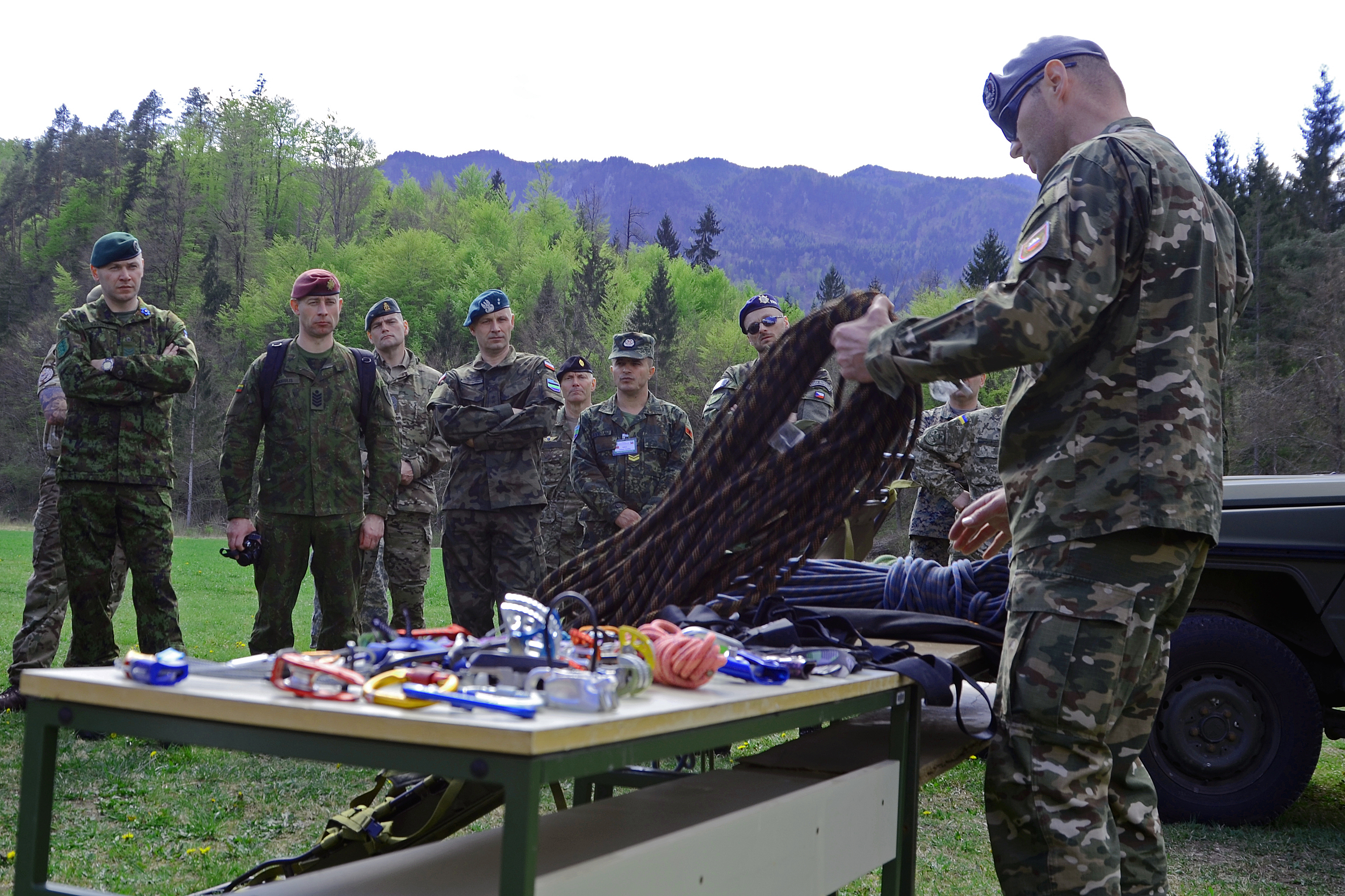 A member of the Slovenian army's 132nd Mountain Infantry Regiment shows participants of the Conference of European Army NCOs some of the equipment Slovenia's soldiers use for mountain warfare. The country has a long history with mountain warfare, including being the setting for World War I's famous Battles of the Isonzo, which partially inspired Ernest Hemingway's
