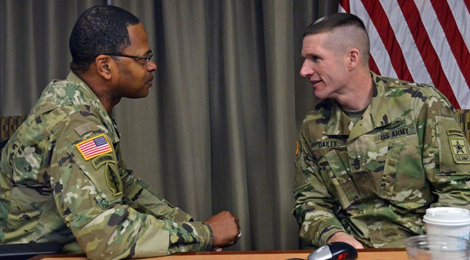 Sgt. Maj. of the Army Daniel A. Dailey, right, talks with Command Sgt. Maj. James Sims, U.S. Army Material command, during a recent Senior Enlisted Council meeting at the U.S. Army Human Resources Command. The SEC meets quarterly to discuss issues affecting Soldiers' welfare. (Photo by Sgt. 1st Class Joy Dulen, U.S. Army Human Resources Public Affairs)