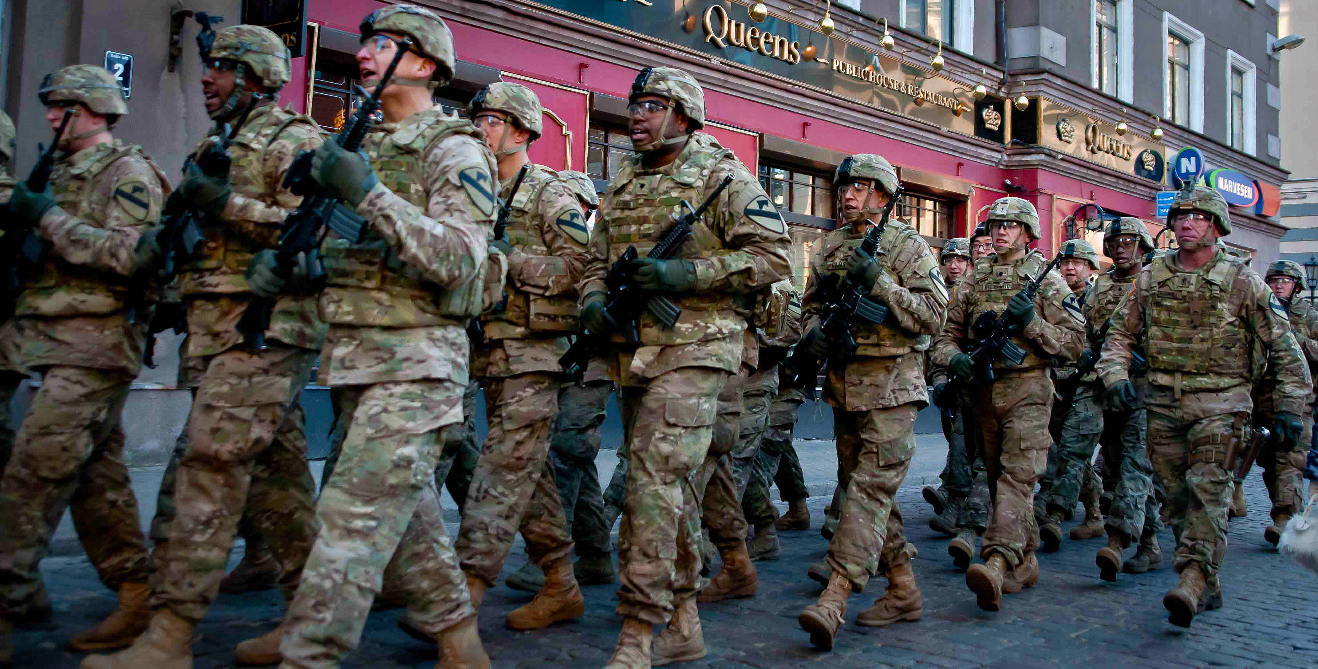 Soldiers from A Company, 2nd Battalion, 8th Cavalry Regiment, 1st Brigade Combat Team, 1st Cavalry Division call cadance as they march through the streets of old Riga as part of the Latvia Day parade that took place in November. The U.S. soldiers participated in the event as part of the U.S. Army Europe-led Operation Atlantic Resolve land force assurance training taking place across Estonia, Latvia, Lithuania and Poland to enhance multinational interoperability, strengthen relationships among allied militaries, contribute to regional stability and demonstrate U.S. commitment to NATO. (Photo by Sgt. 1st Class Jeremy J. Fowler)