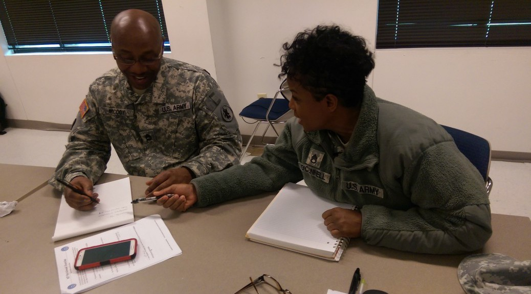 Soldiers talking about writing